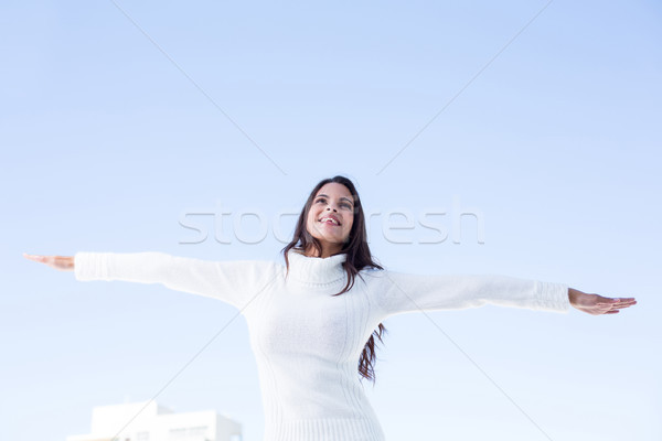 Pretty brunette feeling the air with arms raised up  Stock photo © wavebreak_media