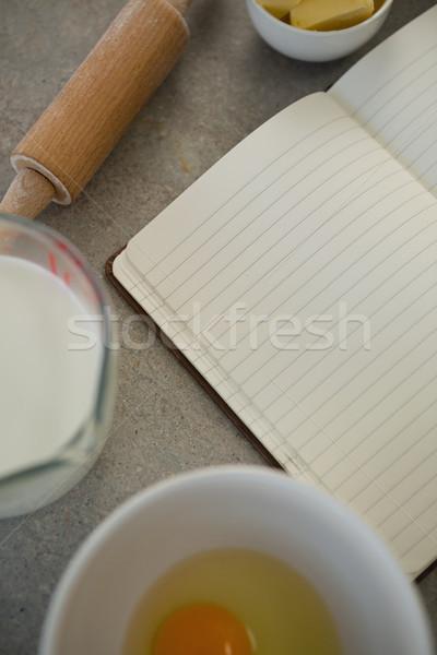 Overhead view of ingredients by open book Stock photo © wavebreak_media