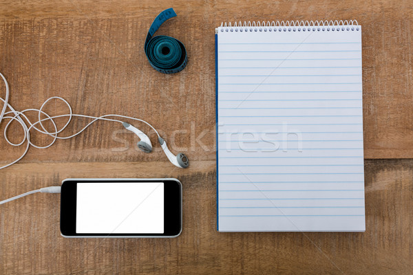 Notepad with smartphone and measuring tape Stock photo © wavebreak_media