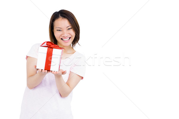 Young woman holding a present Stock photo © wavebreak_media