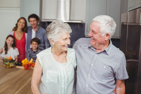 Happy grandparents with family in kitchen Stock photo © wavebreak_media