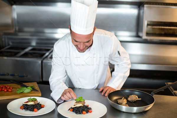 Guapo chef toque comerciales cocina Foto stock © wavebreak_media