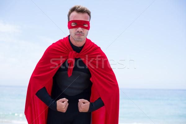 серьезный человека superhero костюм Постоянный морем Сток-фото © wavebreak_media