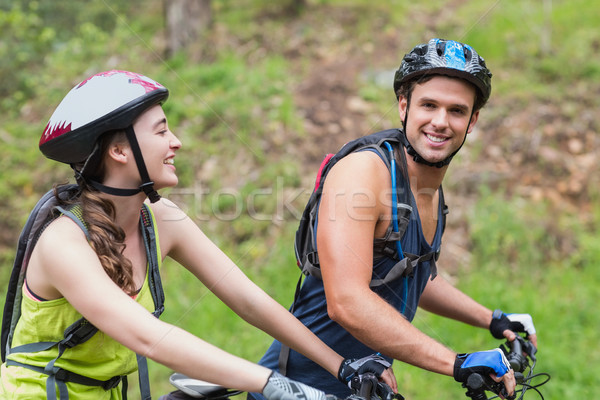 Stock photo: Smiling young couple with bikers
