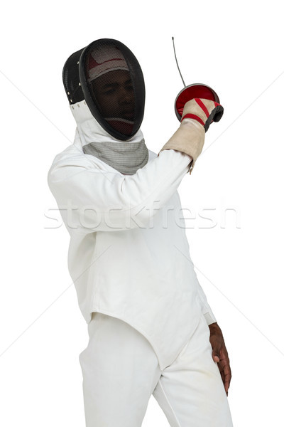 Stock photo: Man wearing fencing suit practicing with sword
