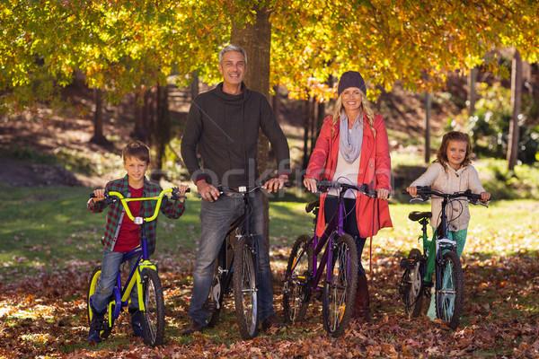 Happy family riding bicycles at park Stock photo © wavebreak_media