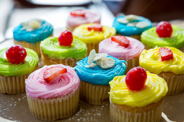 Cupcakes with whipped cream and berries Stock photo © wavebreak_media