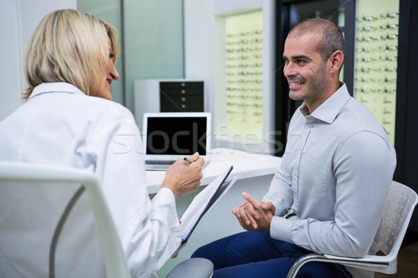 женщины оптик говорить мужчины пациент офтальмология Сток-фото © wavebreak_media
