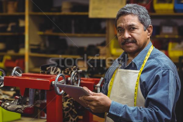 Shoemaker using digital tablet Stock photo © wavebreak_media