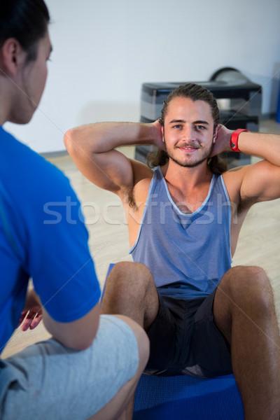 Fitness man praten instructeur gymnasium vrouw Stockfoto © wavebreak_media