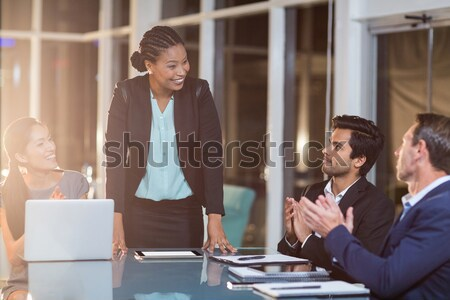 Businesswoman interacting with coworkers in a meeting in the conference room Stock photo © wavebreak_media