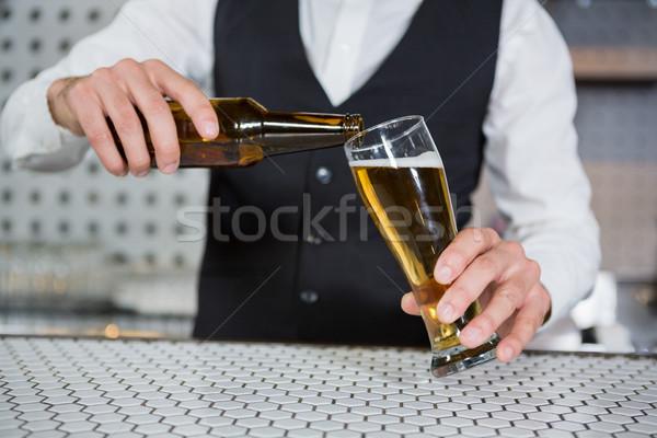 Bartender pouring beer on glass Stock photo © wavebreak_media