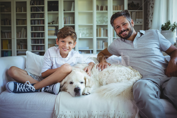Stock fotó: Apa · fia · ül · kanapé · díszállat · kutya · nappali