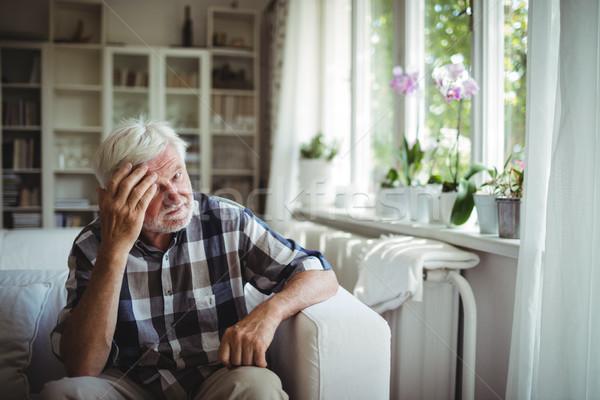 Tensed senior man sitting on sofa Stock photo © wavebreak_media