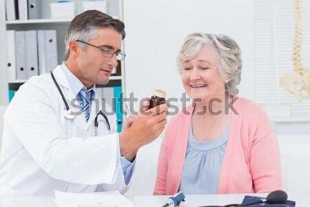 Arts onderzoeken tanden vrouw gelukkig medische Stockfoto © wavebreak_media
