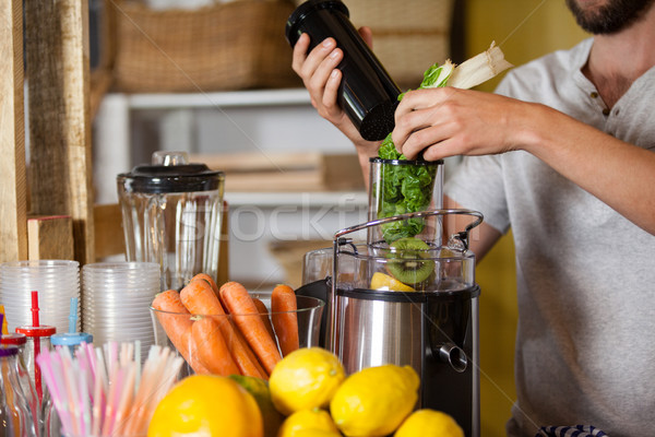 Stock photo: Male staff preparing a juice