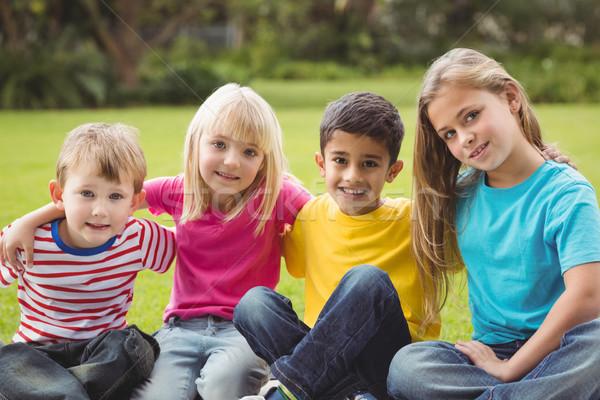 Mosolyog osztálytársak ül fű lány gyermek Stock fotó © wavebreak_media