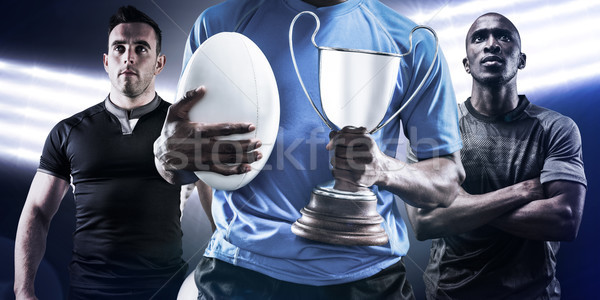Composite image of mid section of sportsman holding trophy and r Stock photo © wavebreak_media