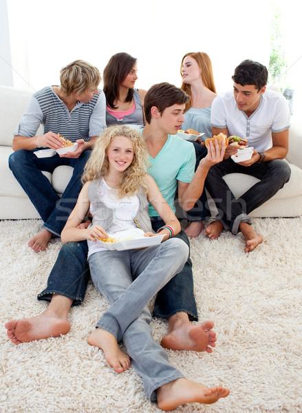 Teenagers eating burgers and fries Stock photo © wavebreak_media