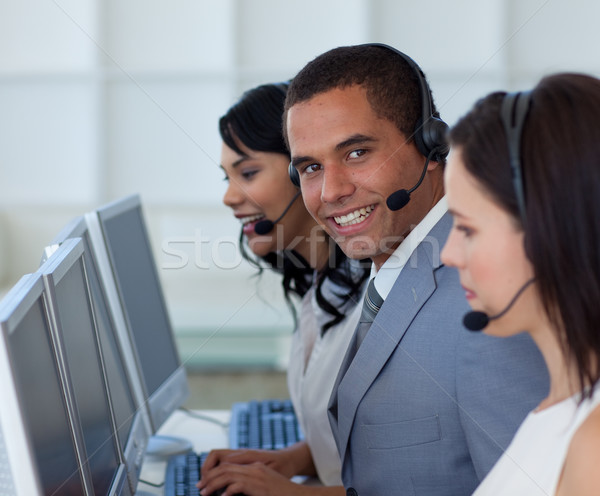 Smiling businessman in a call canter  Stock photo © wavebreak_media