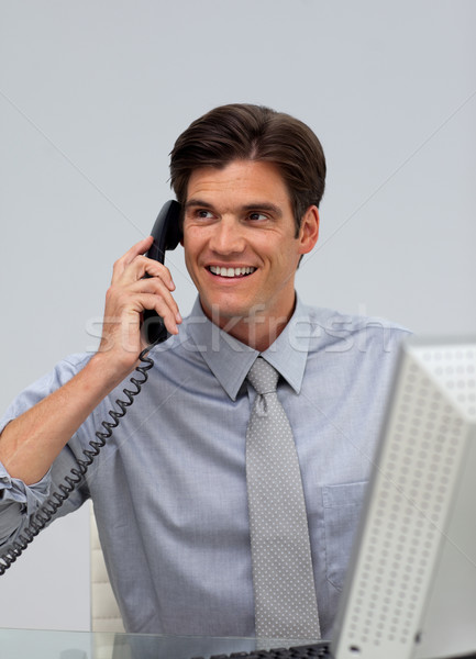 Assertive caucasian businessman on phone  Stock photo © wavebreak_media