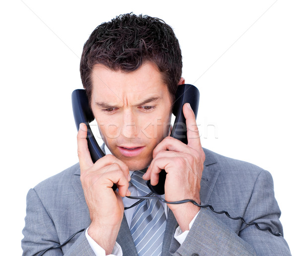 Young businessman tangle up in phone wires  Stock photo © wavebreak_media