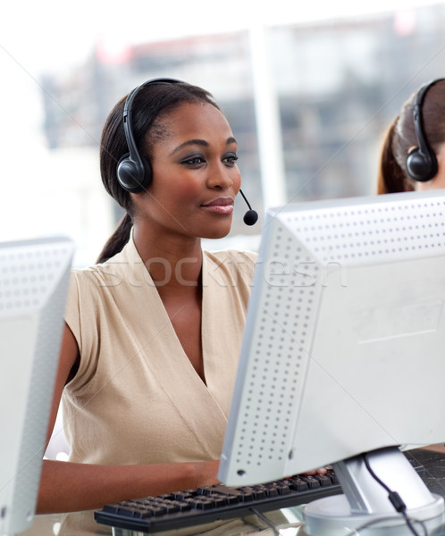 Serious ethnic businesswoman working in a call center Stock photo © wavebreak_media