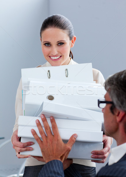 Young businesswoman and her manager carrying a pile of folders Stock photo © wavebreak_media