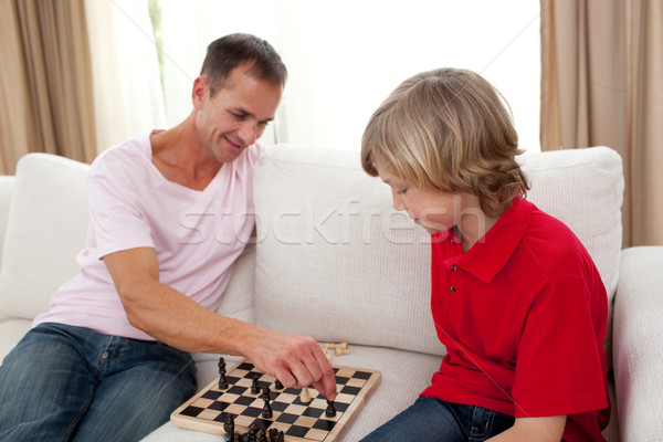 Attentive father playing chess with his son  Stock photo © wavebreak_media