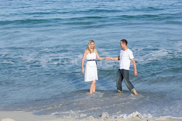 Animado amantes beira-mar juntos água Foto stock © wavebreak_media