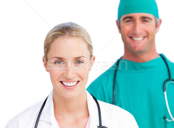 Blond female doctor and smiling surgeon Stock photo © wavebreak_media