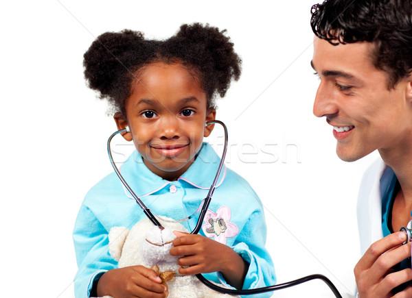 Atento médico jogar paciente branco médico Foto stock © wavebreak_media