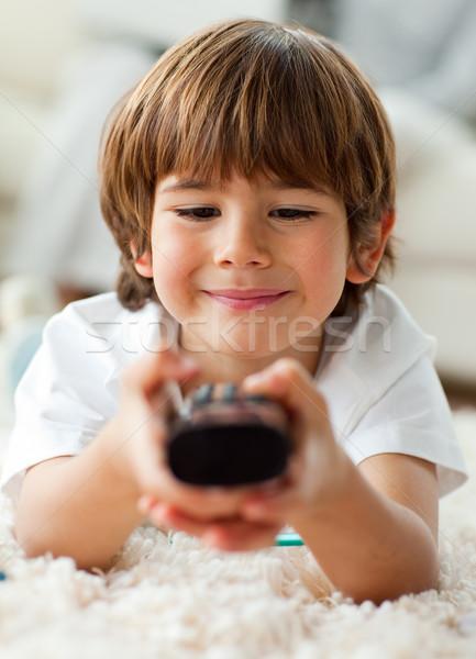 Aranyos kicsi fiú tart távoli padló Stock fotó © wavebreak_media