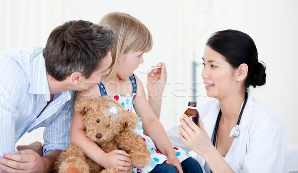 Professional female doctor giving syrup to a little girl  Stock photo © wavebreak_media