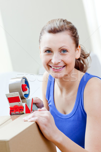 Radiant woman packing boxes in the living-room Stock photo © wavebreak_media