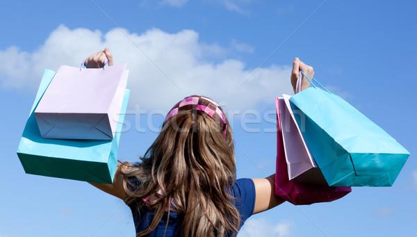 Cute woman holding shopping bags outdoor  Stock photo © wavebreak_media