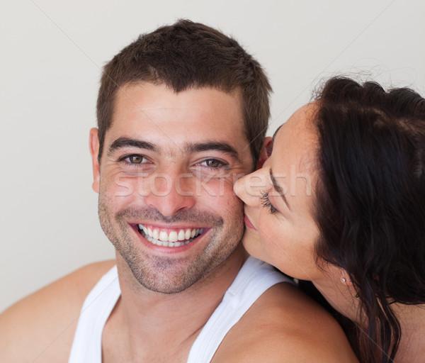 Close-up of girlfriend kissing her boyfriend in bed  Stock photo © wavebreak_media