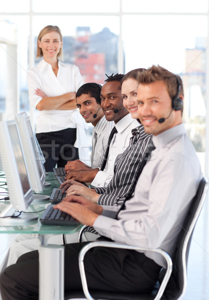 Cheerful manager leading her representative team in a office Stock photo © wavebreak_media