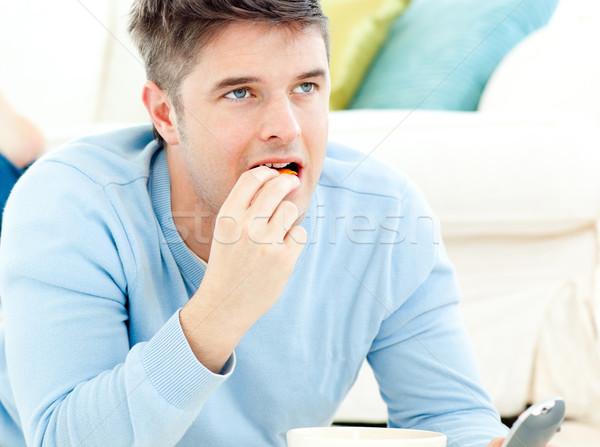 Jonge man grond eten plakje pizza home Stockfoto © wavebreak_media