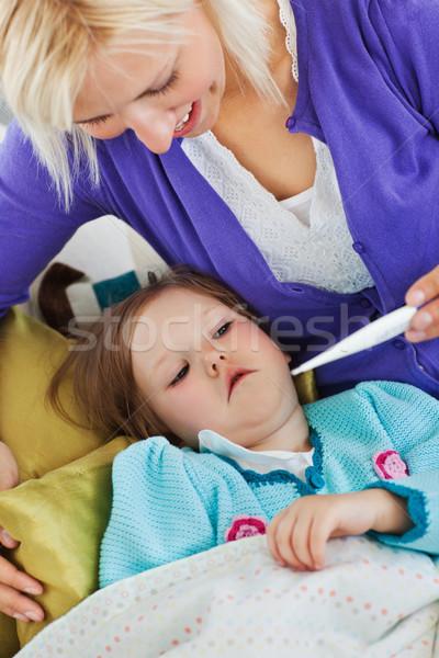 внимательный матери температура домой детей улыбаясь Сток-фото © wavebreak_media