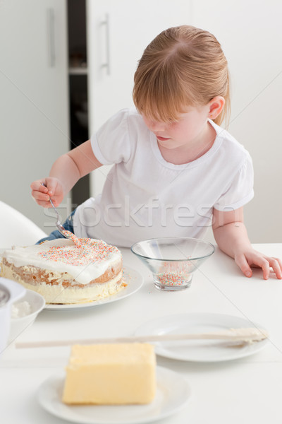 Adorable girl baking in her kitchen at home Stock photo © wavebreak_media