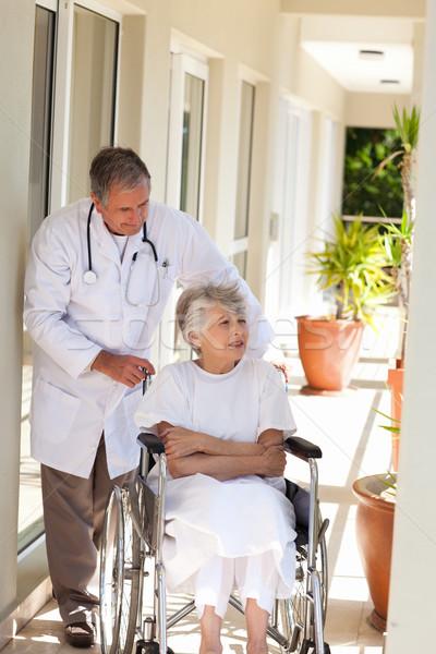 Senior doctor talking with his patient Stock photo © wavebreak_media