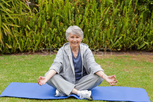 Retired woman practicing yoga in the garden Stock photo © wavebreak_media