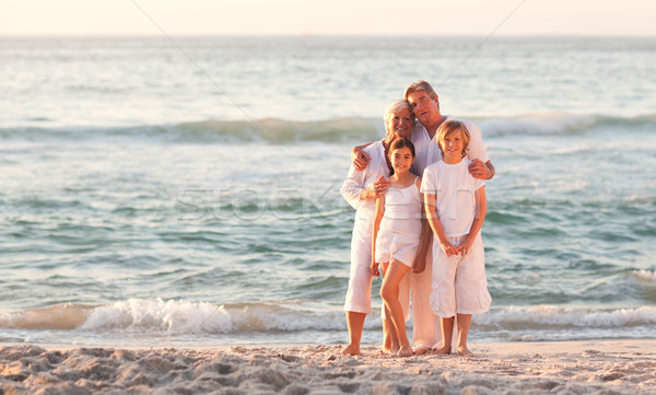 Retrato adorable familia playa cielo Foto stock © wavebreak_media