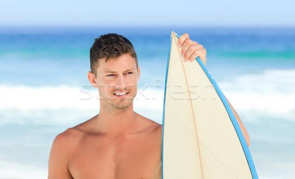 Handsome man with his surfboard Stock photo © wavebreak_media