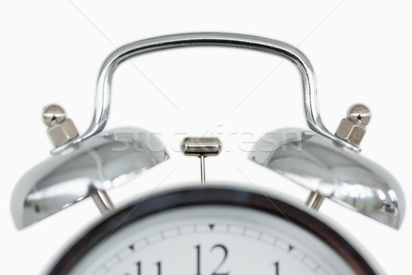 Stock photo: Close up of an old fashioned alarm clock against a white background