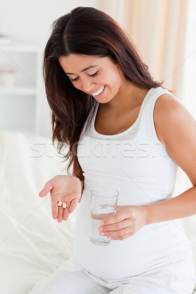 красивый беременная женщина стекла воды таблетки Сток-фото © wavebreak_media