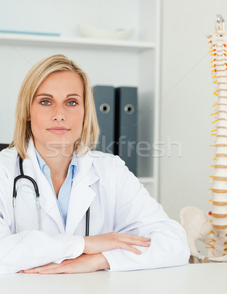 Serious doctor with model spine next to her looks into camera in her office Stock photo © wavebreak_media