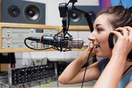 Jovem rádio hospedeiro fones de ouvido estação trabalhar Foto stock © wavebreak_media