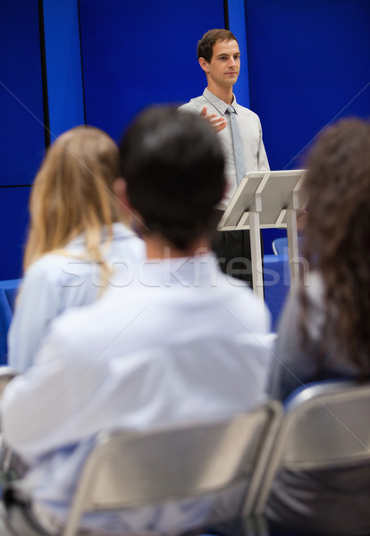 Portrait of a young man doing a presentation to business people Stock photo © wavebreak_media
